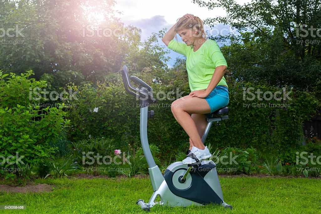 Pretty blonde on the exercise bike royalty-free stock photo