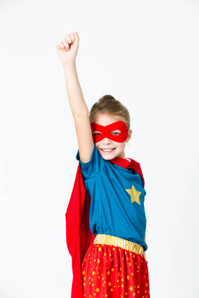 pretty blonde supergirl with red mask and red cape stock photo