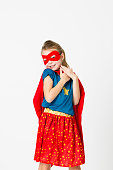 pretty blonde supergirl with red mask and red cape