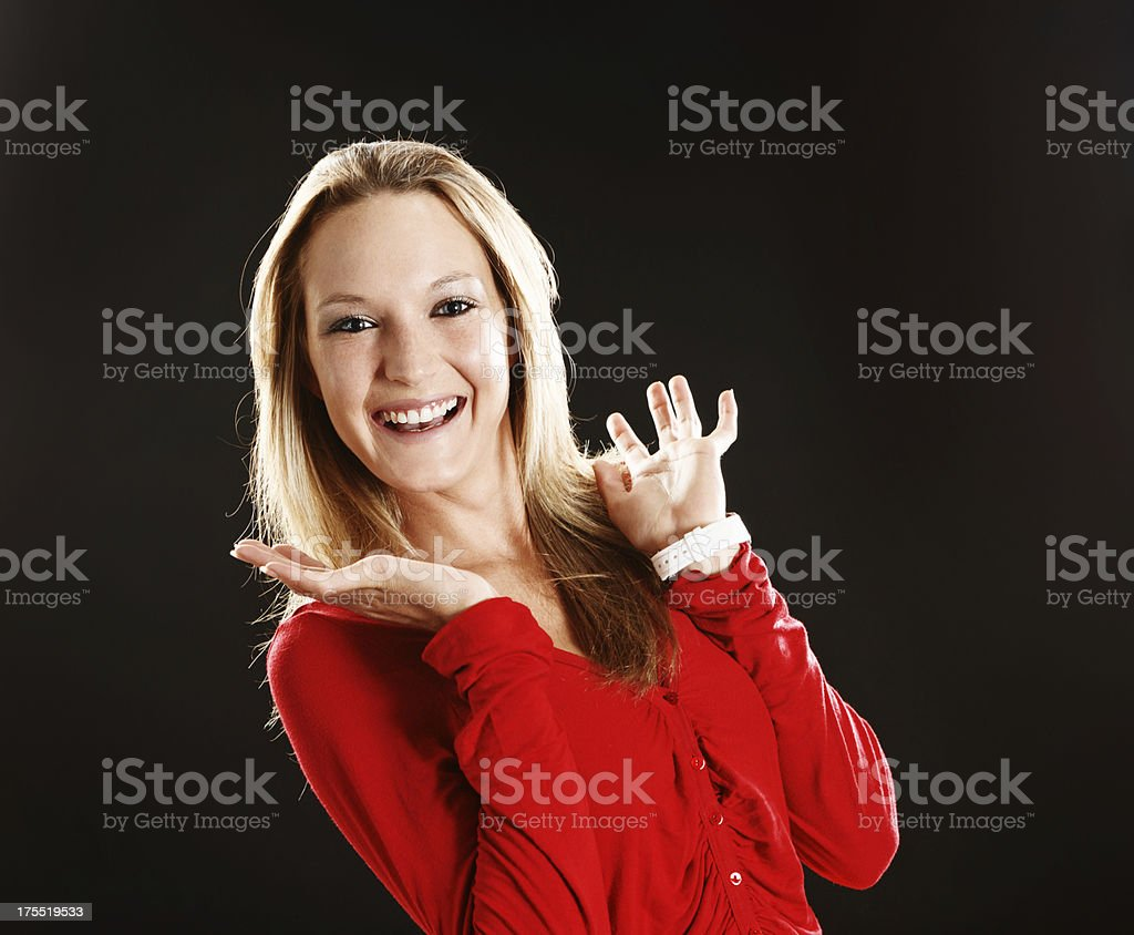 Pretty blonde wearing red laughs in excited delight stock photo
