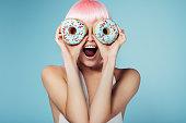 istock Pretty blonde with multi-colored donuts 692840848