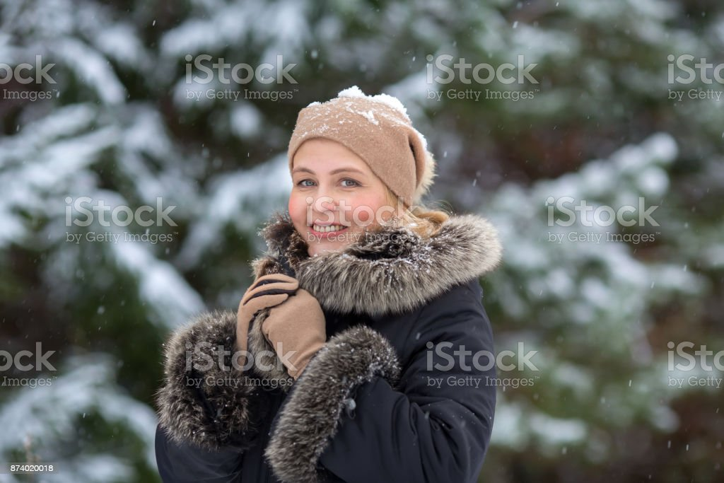 Pretty blonde woman in winter forest royalty-free stock photo