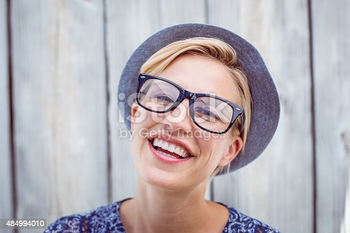 istock Pretty blonde woman wearing hipster glasses 484994010