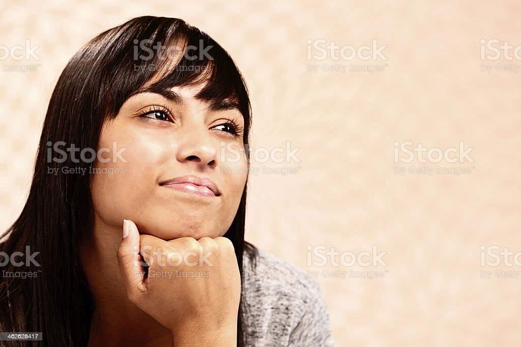 Pretty brunette daydreams, smiling and thinking happy thoughts royalty-free stock photo