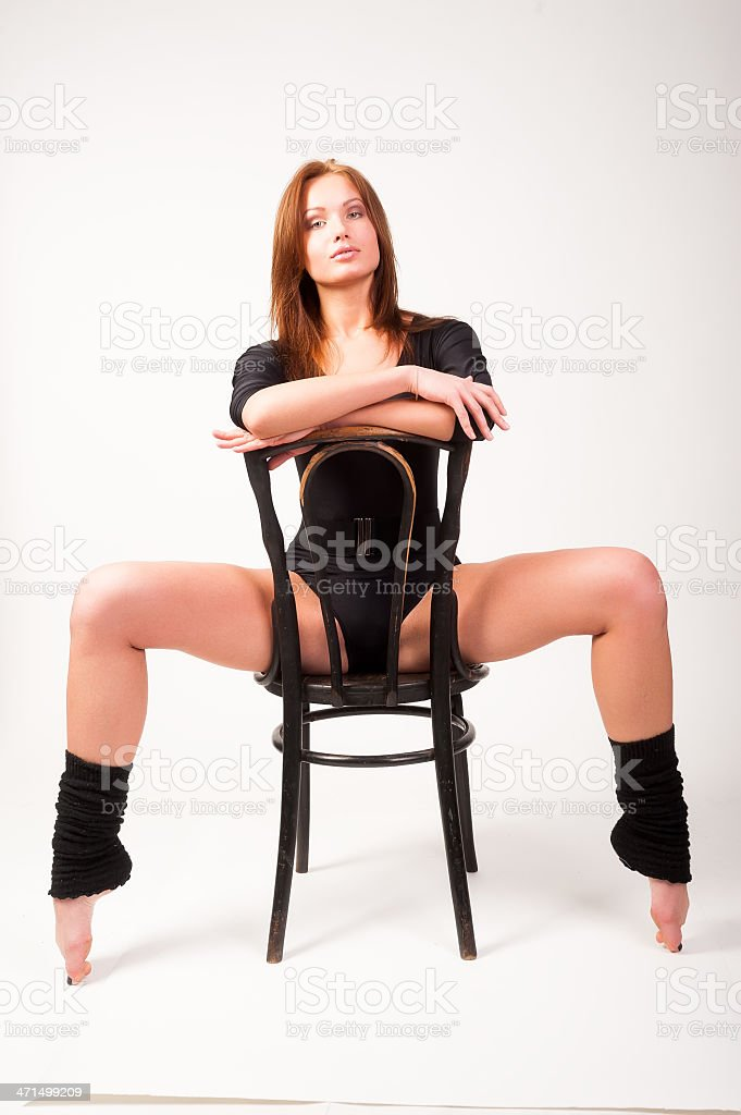 Pretty brunette girl on chair royalty-free stock photo