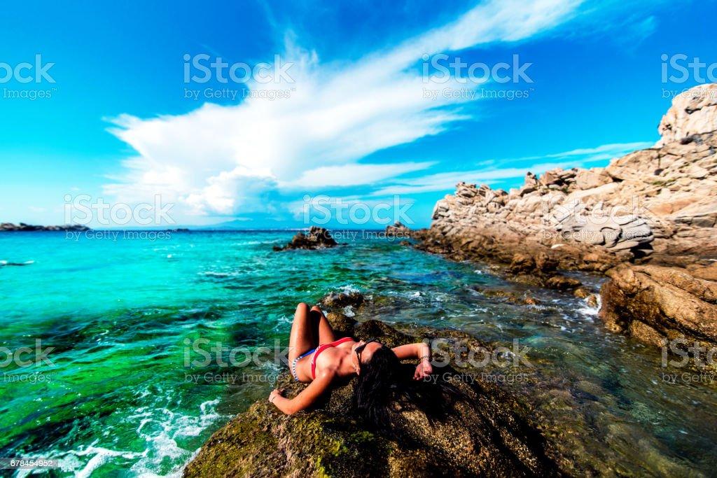 Pretty brunette girl sunbathing outdoor royalty-free stock photo