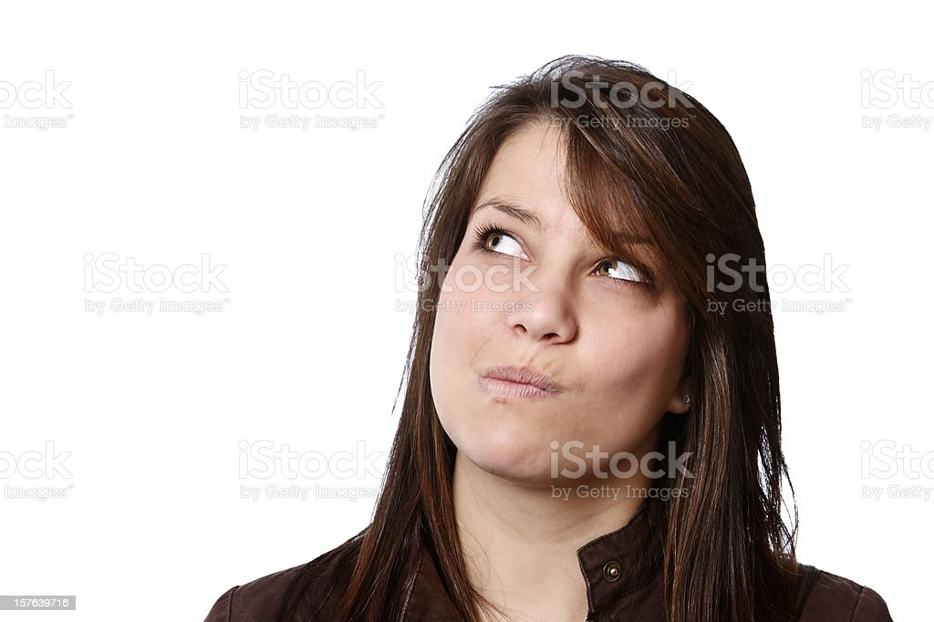 Pretty brunette looks up at something only she can see stock photo