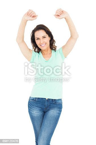 istock Pretty brunette with arms up 698120476
