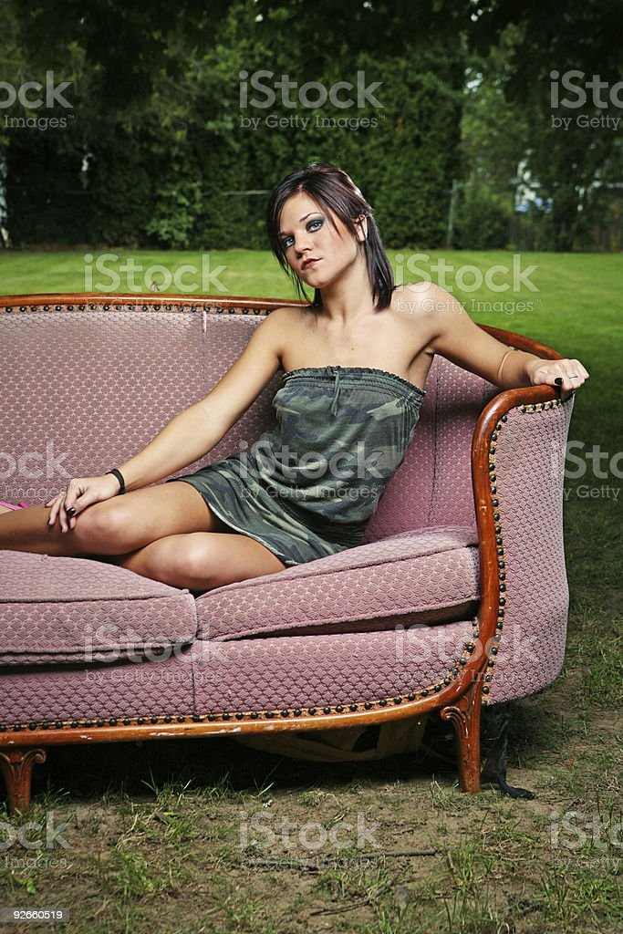 Pretty Brunette Woman on a Velvet Couch royalty-free stock photo