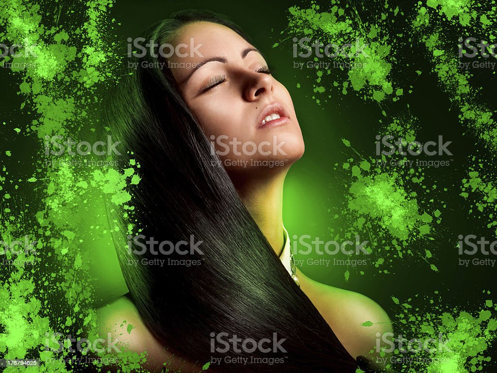 Pretty Brunette young woman with green splashes in studio royalty-free stock photo