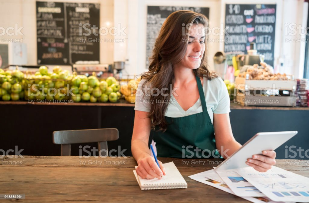 Pretty Business Owner Of Juice Bar Working With Her Tablet