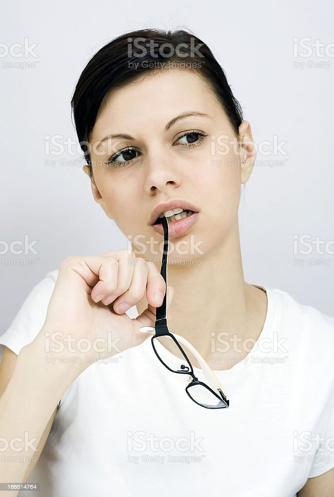 Pretty business woman thinking royalty-free stock photo