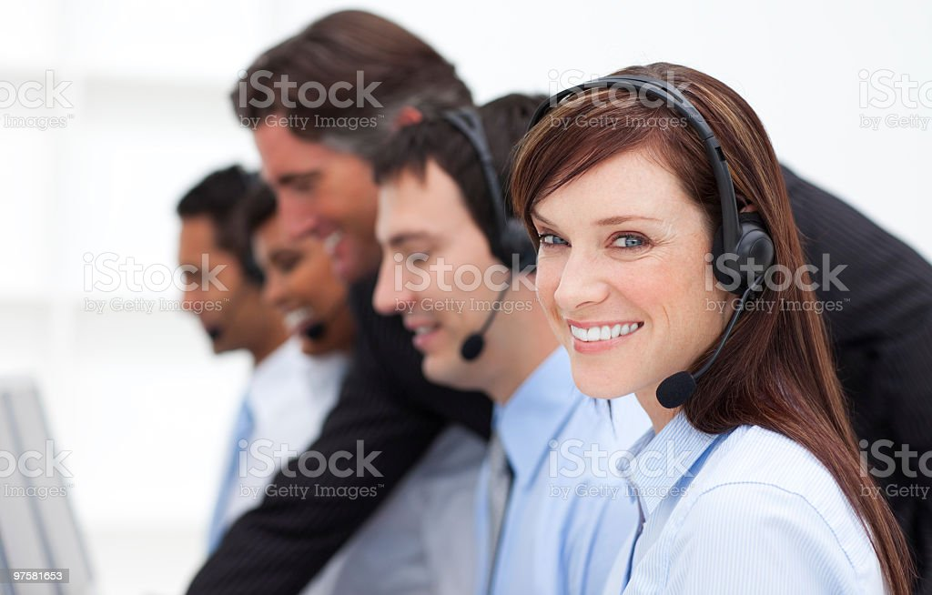 Pretty businesswoman and her team working in a call center royalty-free stock photo
