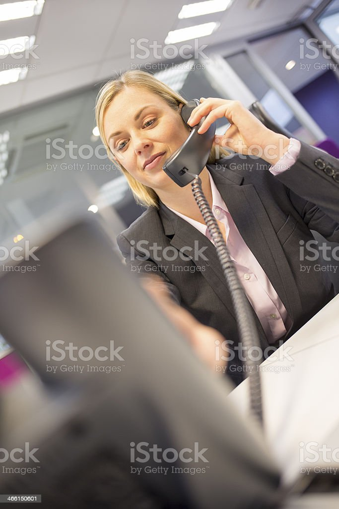 Pretty Businesswoman telephoning in her office stock photo