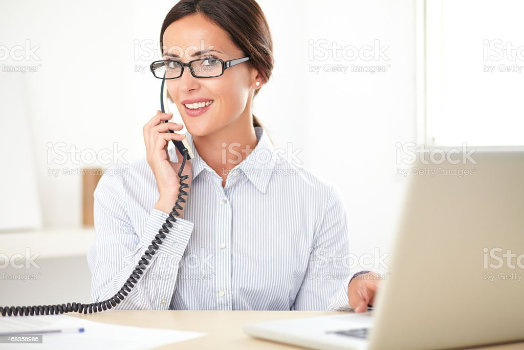 Pretty businesswoman using the phone in the office royalty-free stock photo