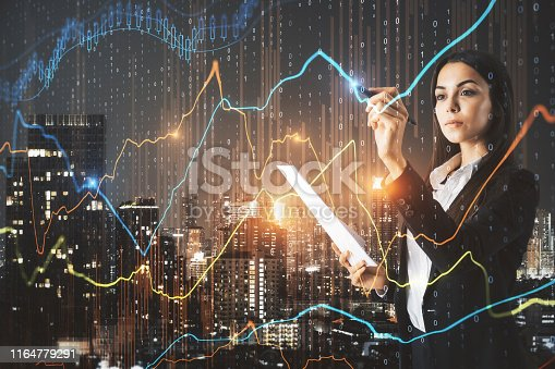 Pretty businesswoman with document in hand using creative forex chart interface on blurry illuminated night city background. Finance and trade concept. Double exposure