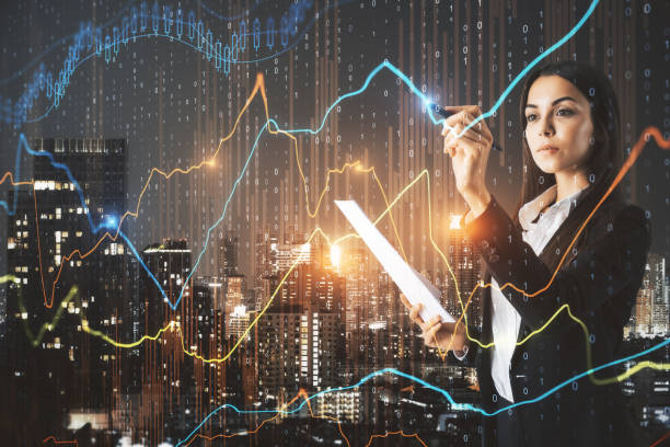 Pretty businesswoman with forex chart stock photo