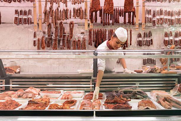 Pretty Butchery Woman working. stock photo