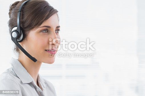 istock Pretty call centre agent smiling 846838376