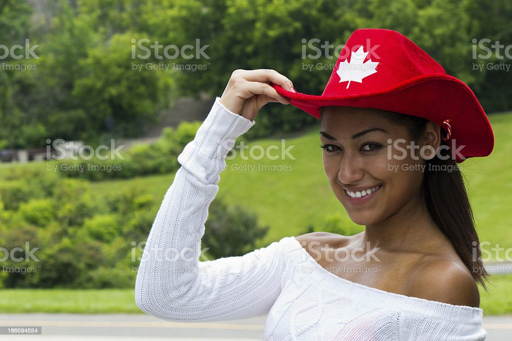 Pretty Canadian girl in a red hat stock photo