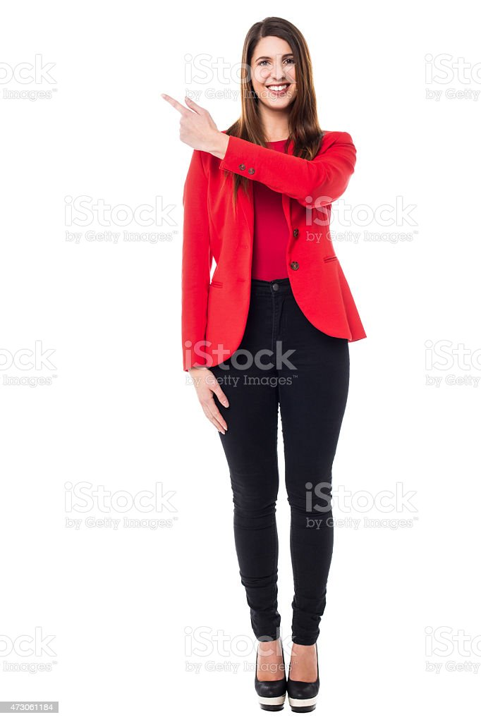 Pretty caucasian woman pointing backwards - Royalty-free 2015 Stock Photo