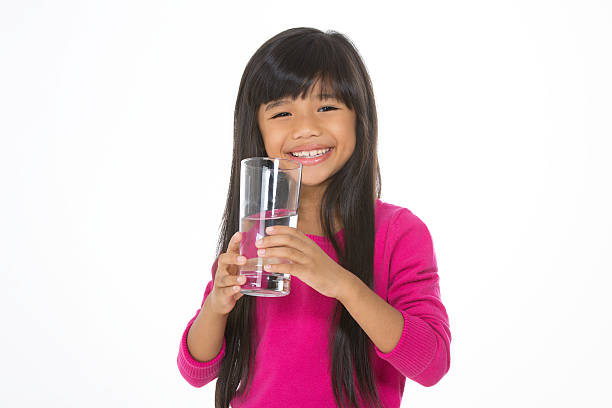 pretty child drinks water stock photo