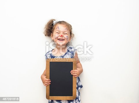 istock Pretty Child Holding A Blackboard 487091818