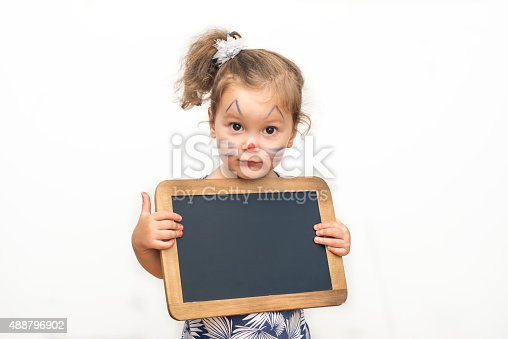 istock Pretty Child Holding A Blackboard 488796902