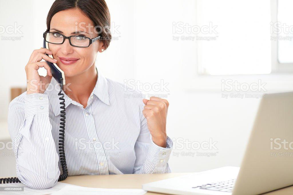 Pretty company secretary conversing on the phone royalty-free stock photo