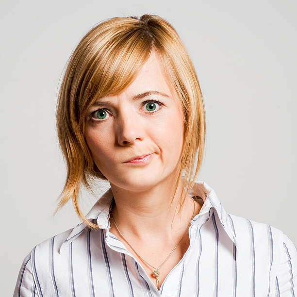 pretty confused young blond woman with perplexed facial expression rolling eyes stock pictures, royalty-free photos & images