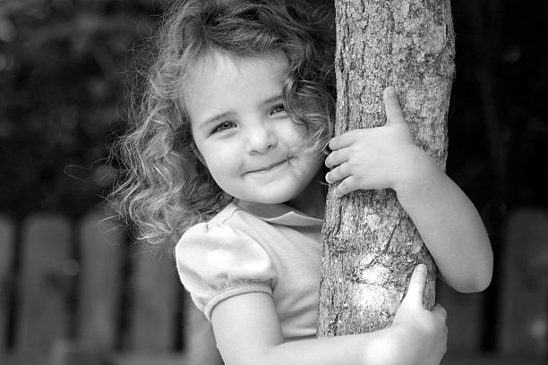 pretty curls holding tree stock photo