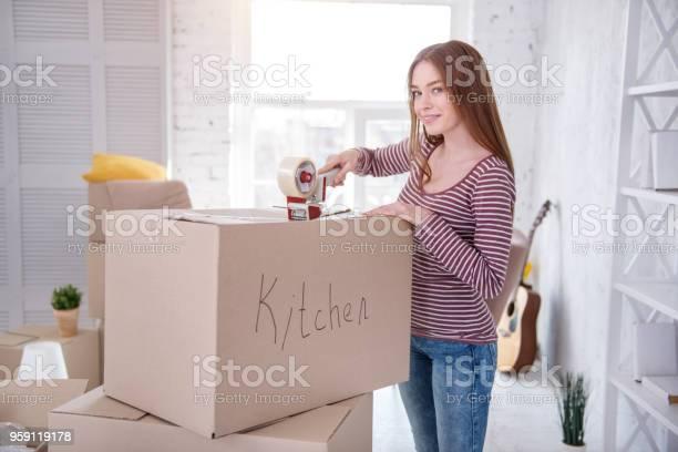 Pretty darkhaired woman packing kitchen utensils picture id959119178?b=1&k=6&m=959119178&s=612x612&h=zhbd0q1uusbgeaf2ddxpvuijbyq 2ywq1rw1mwzrwy8=
