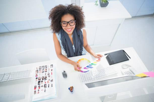 Pretty designer working at her desk stock photo