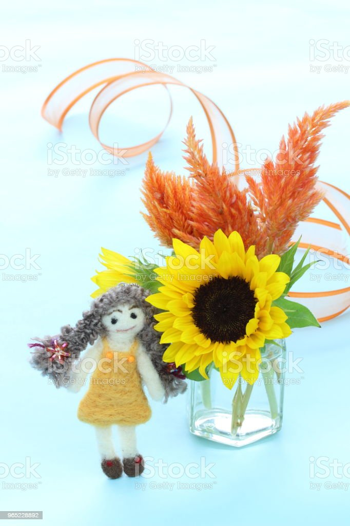 pretty doll and sunflower royalty-free stock photo