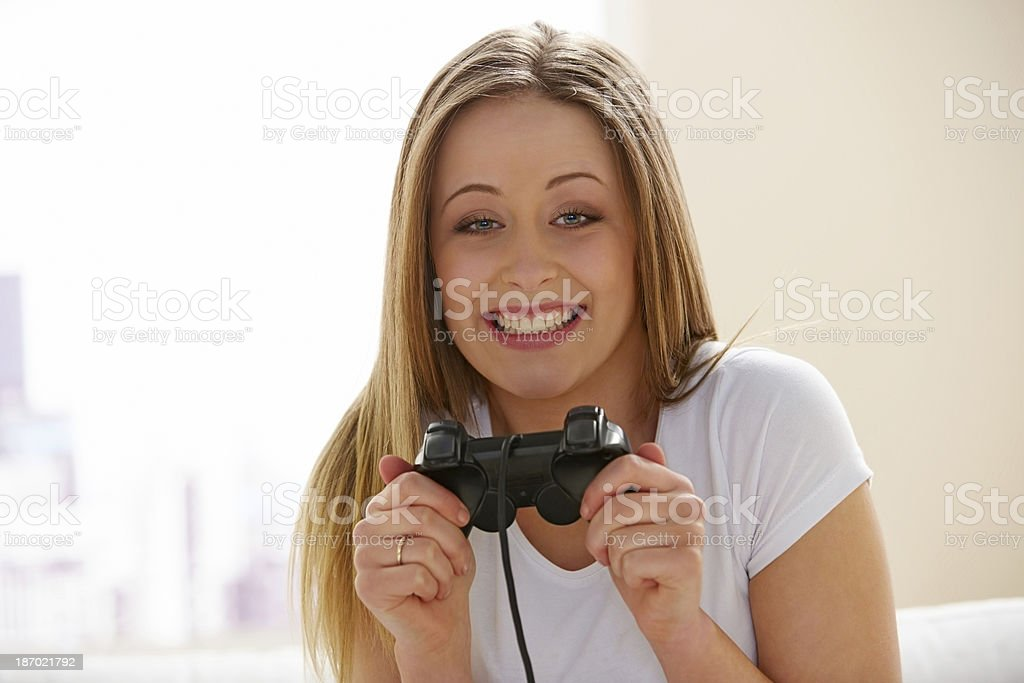Pretty excited young girl playing video game at home royalty-free stock photo