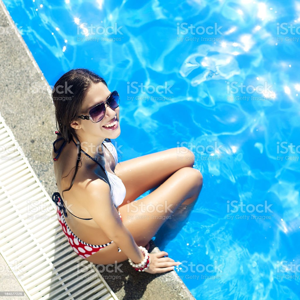 Pretty female at the edge of pool royalty-free stock photo