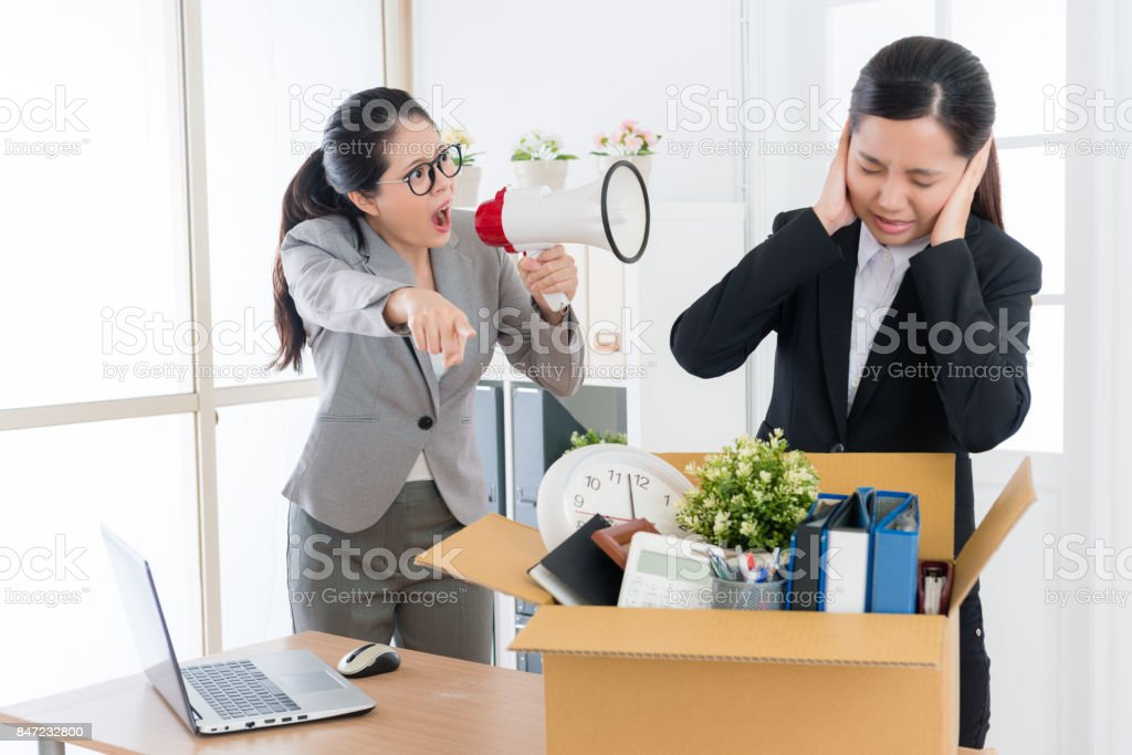 pretty female boss speaking with business worker stock photo