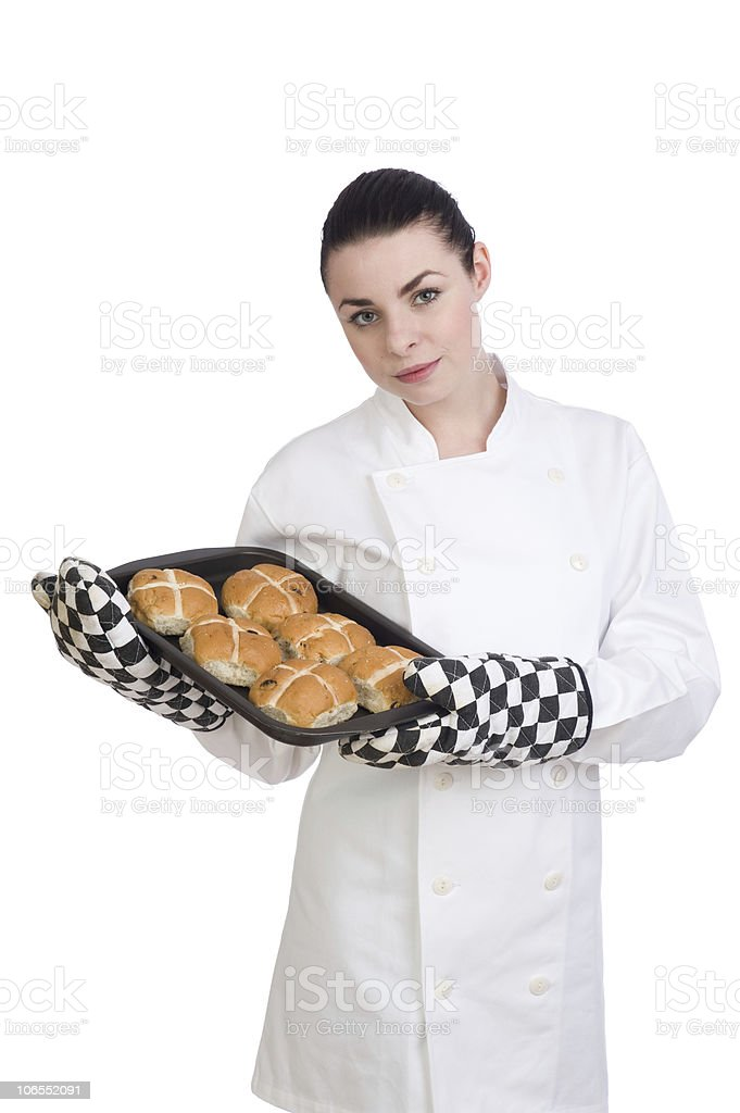 Pretty female chef presents her Hot Cross Buns royalty-free stock photo