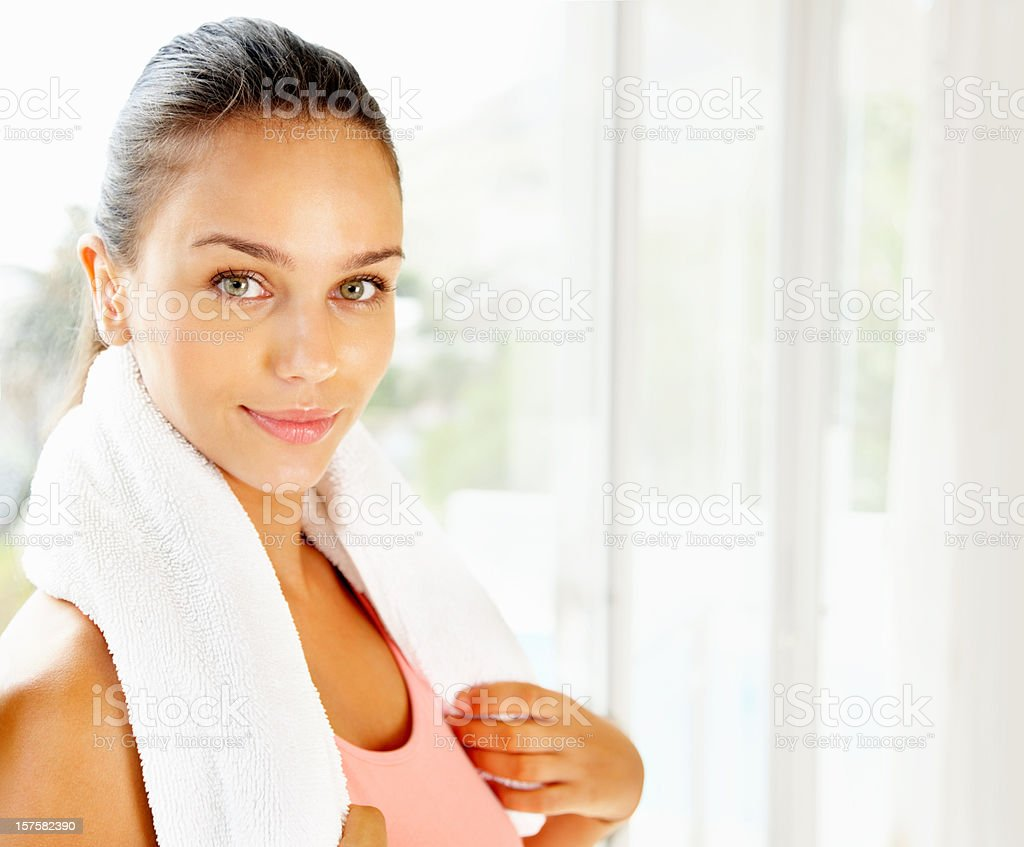 Pretty female during a break from gym royalty-free stock photo