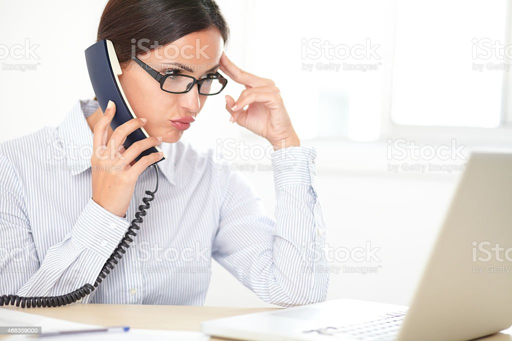 Pretty female executive conversing on the phone royalty-free stock photo