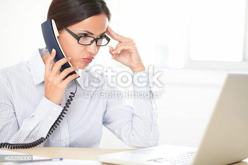 Pretty Female Executive Conversing On The Phone Stock Photo & More Pictures of 2015