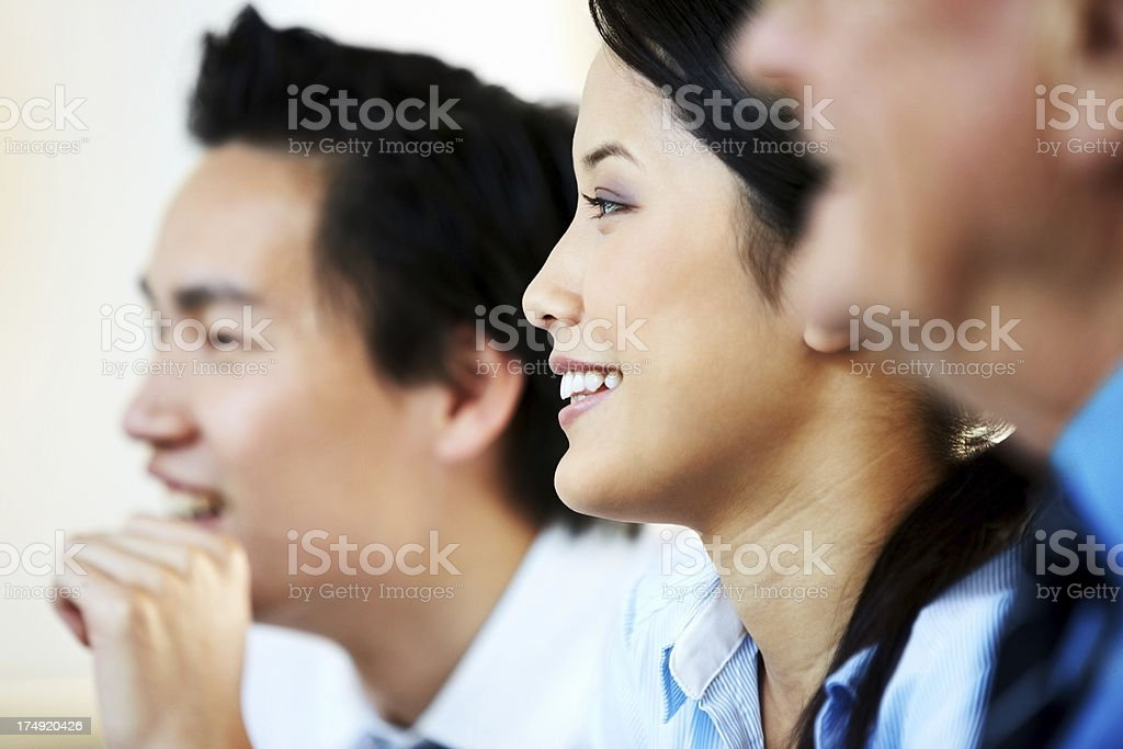 Closeup image of pretty female executive smiling during company...