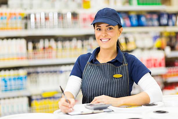 pretty female hardware worker stock photo