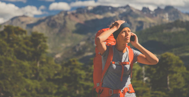pretty, female hiker in high mountains , calling for help - stranded stock pictures, royalty-free photos & images