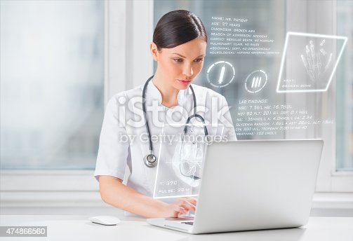 864464934istockphoto Pretty female medicine doctor working with modern computer interface 474866560