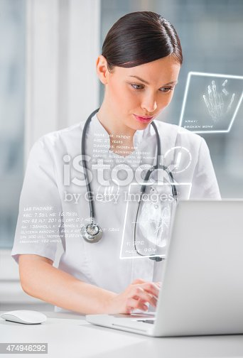 864464934istockphoto Pretty female medicine doctor working with modern computer interface 474946292