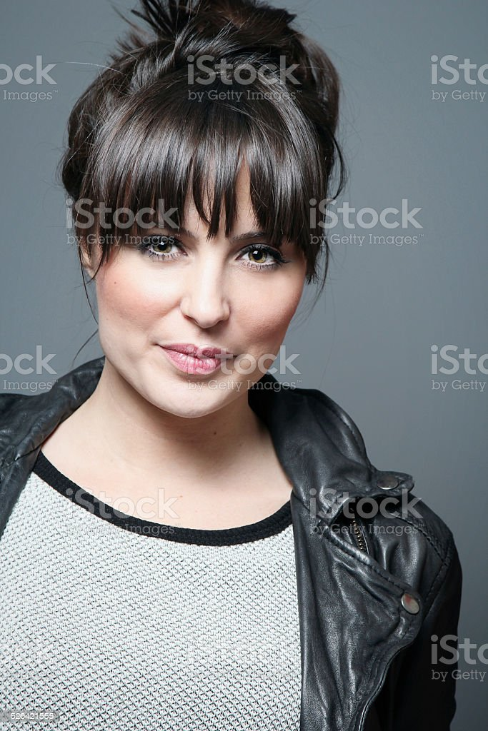 Pretty female model wearing leather jacket stock photo
