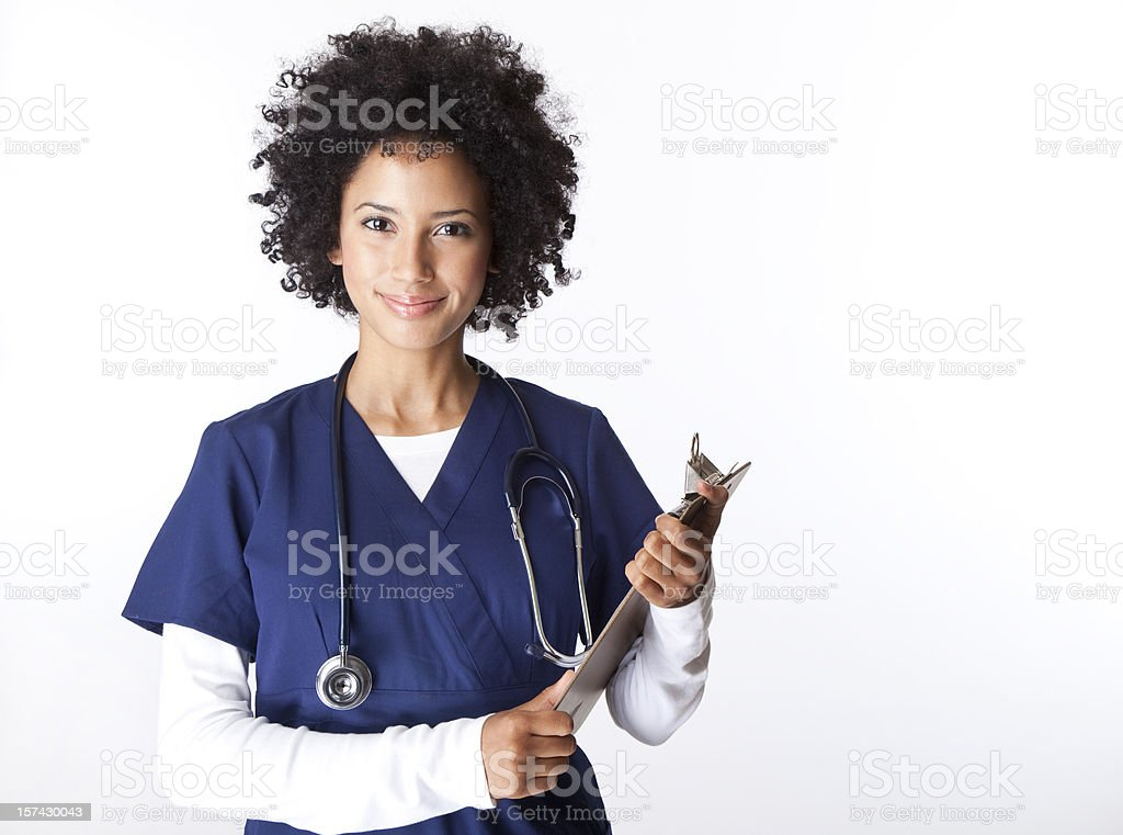 pretty female nurse with curly hair holding clipboard stock photo
