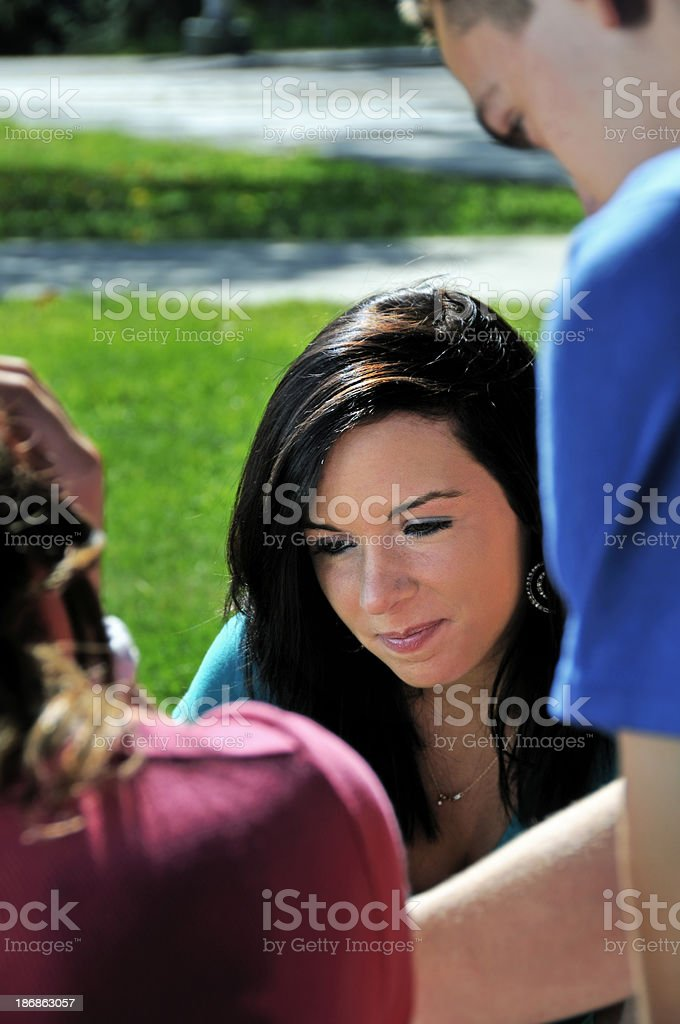 Pretty Female Student Studies with Friends stock photo