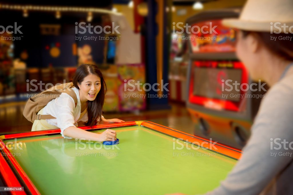 pretty female students going to the playground stock photo